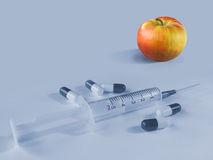 apple-ou-comprimidos-e-seringa-1584437